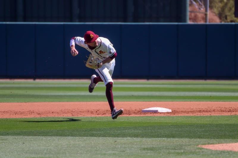 Drew Swift (6) throws to first against Washington State