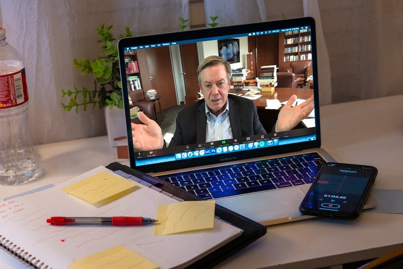 A photo illustration of a meeting with Michael Crow over zoom.