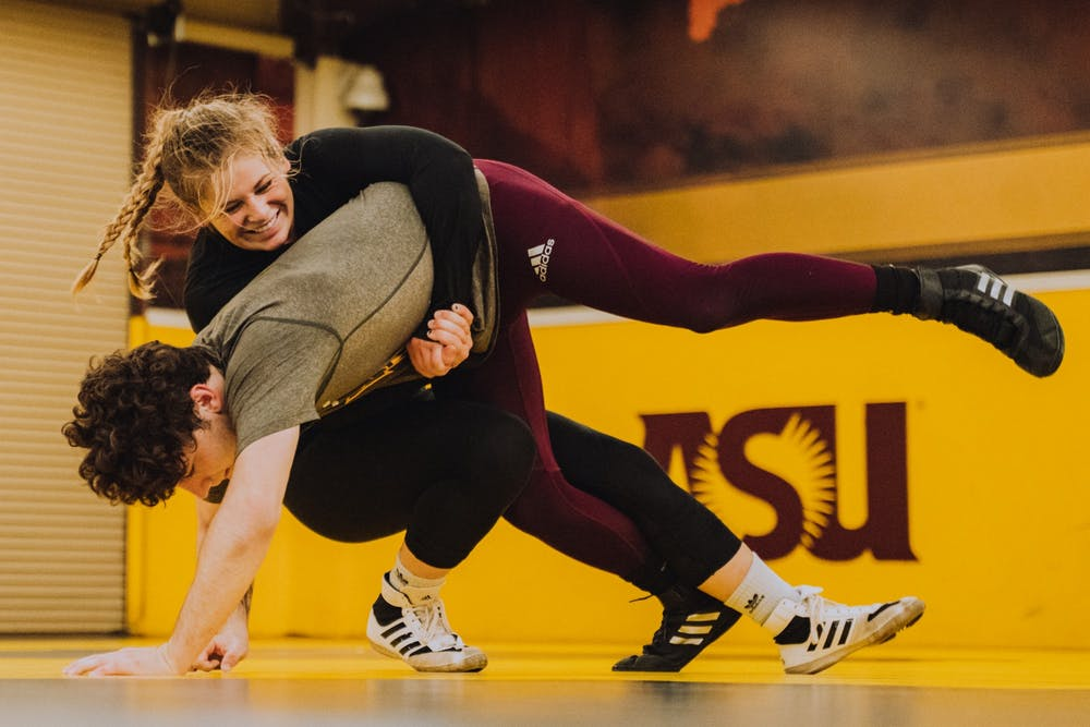 ASU wrestler Marlee Smith takes down an opponent at a match.
