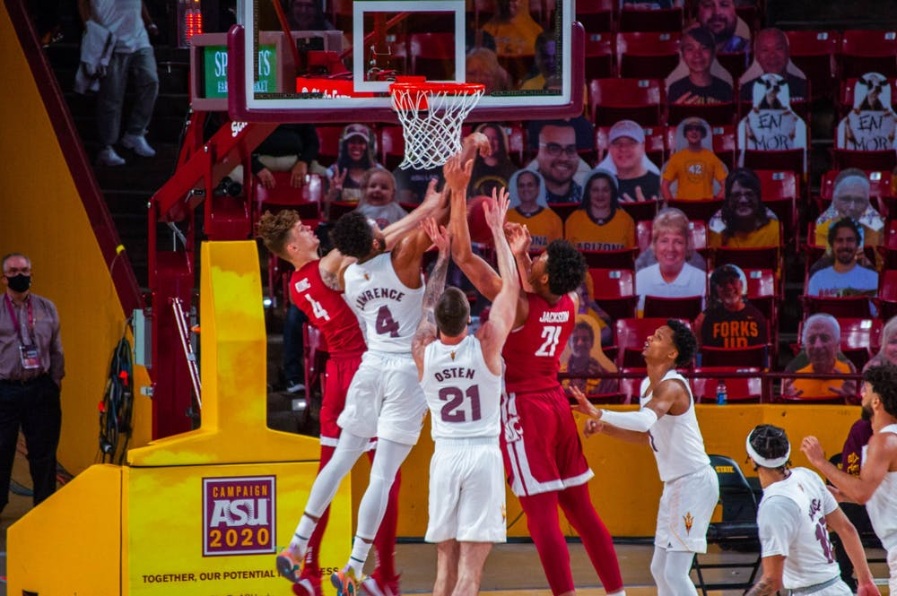 The ASU men's basketball team fights for control of the ball against Washington State