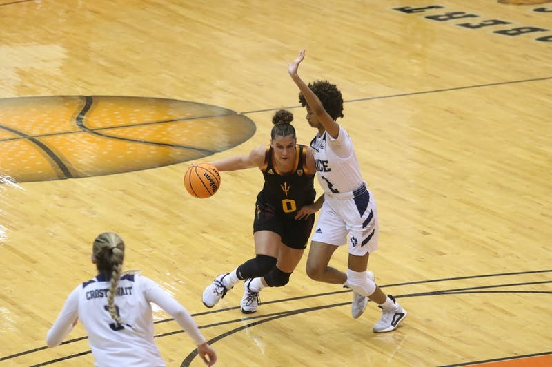 Taya Hanson (0) drives against Rice University