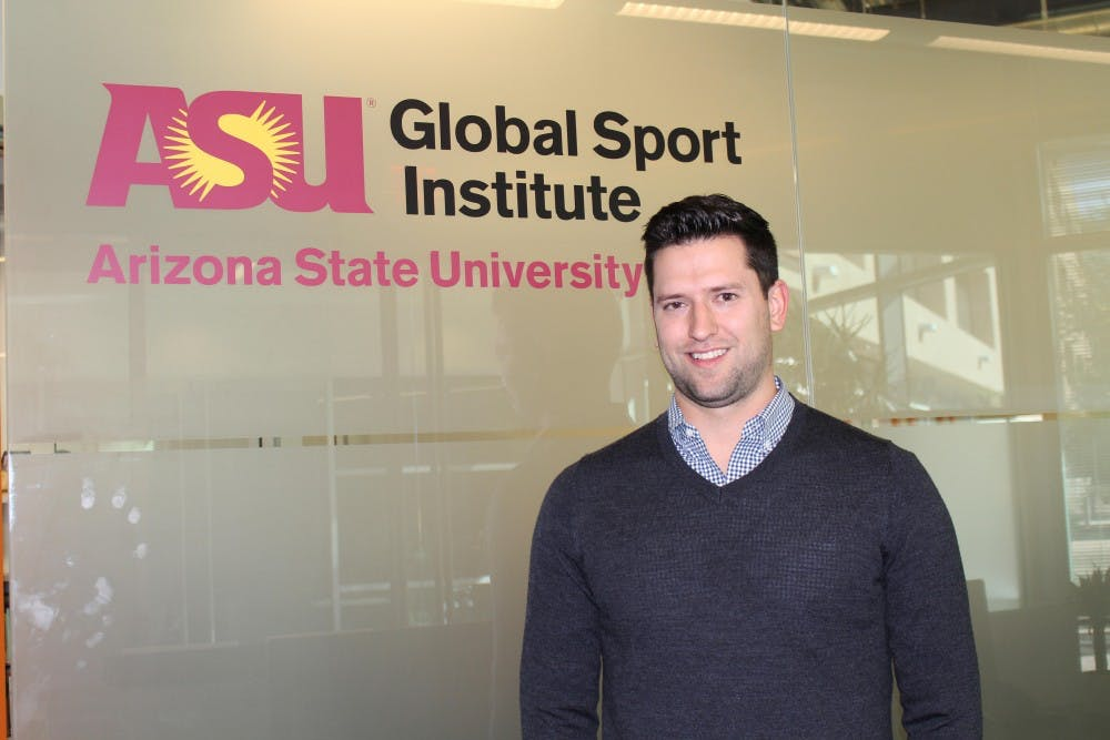 Jeff Kunowski, stands in front of the Global Sport Institute