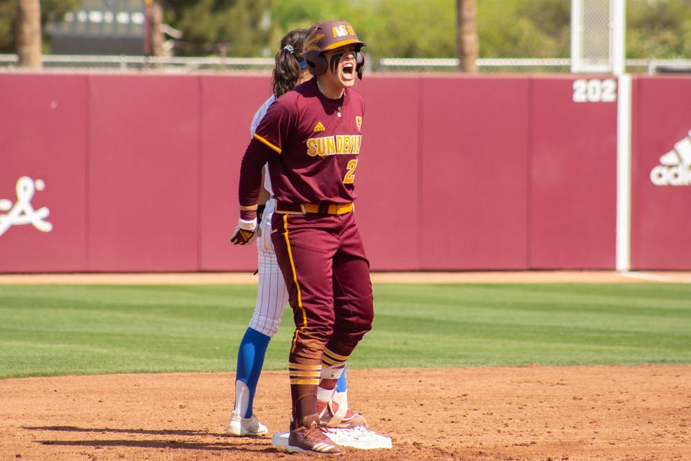 Maddi Hackbarth (23) gets excited after hitting a double against UCLA