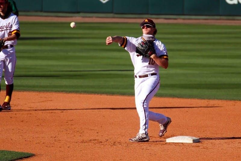 Sean McLain throws a baseball while warming up