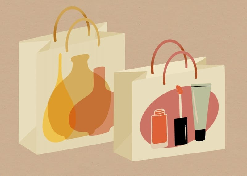 An illustration of two shopping bags with glassware and vegan lipstick products.