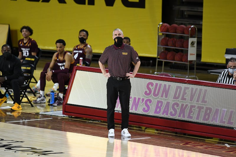 ASU Men's Basketball coach Bobby Hurley watches a plat during the game against UA