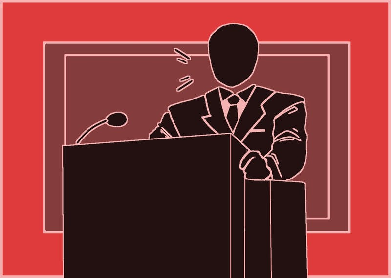 A person stand in front of a podium.