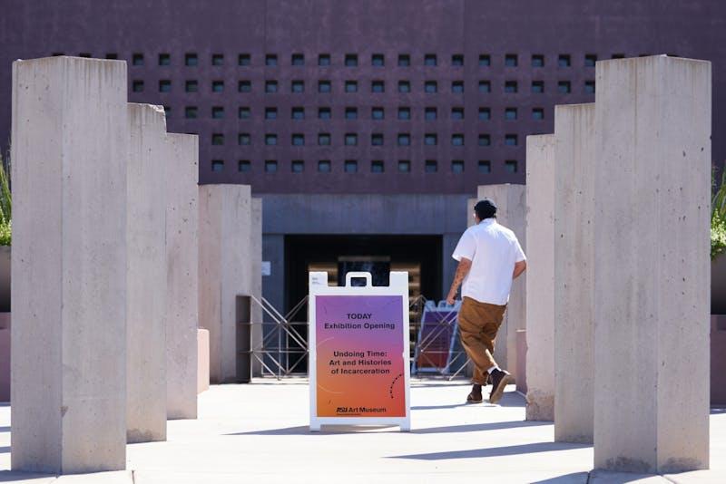 A man walks toward the entrance to the ASU Art Museum.