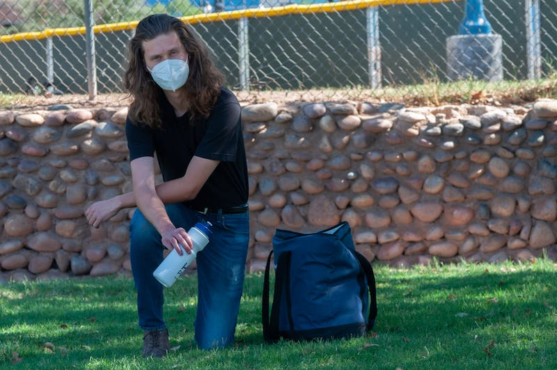 Austin Davis, poses for a photo with re-useable water bottles in hand