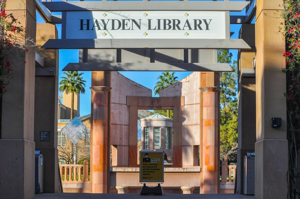 The entrance to the Hayden Library basement is shown with an ASU Community of Care Sign in the middle of the stair entrance.