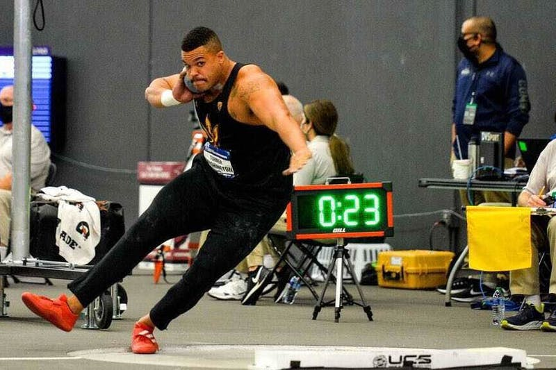 Turner Washington throws during the NCAA Indoor Track and Field Championships