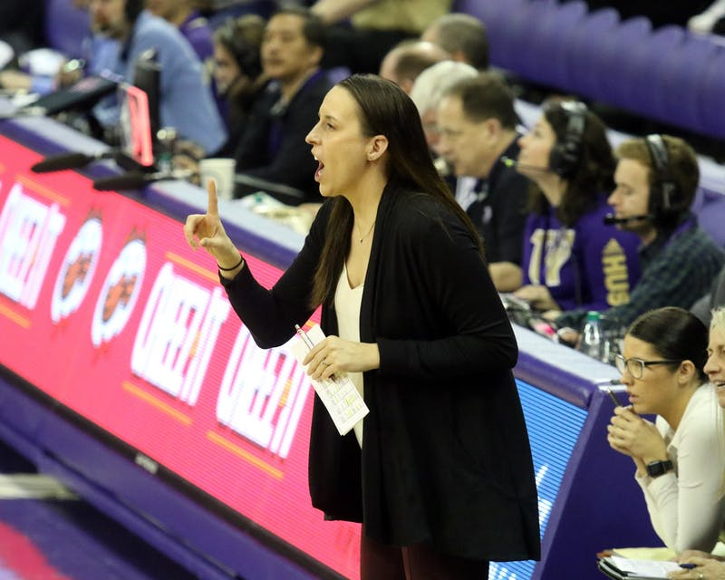 Angie Nelp gives instructions to her team from the sideline