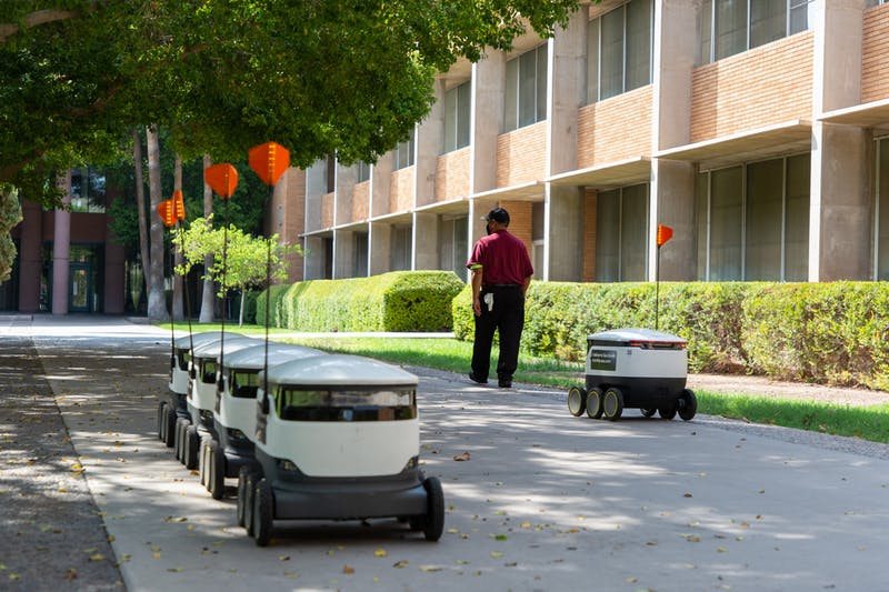 ASU food delivery robots are stationed in front of each other after delivering food on the Tempe campus on Friday, Aug. 28, 2020.