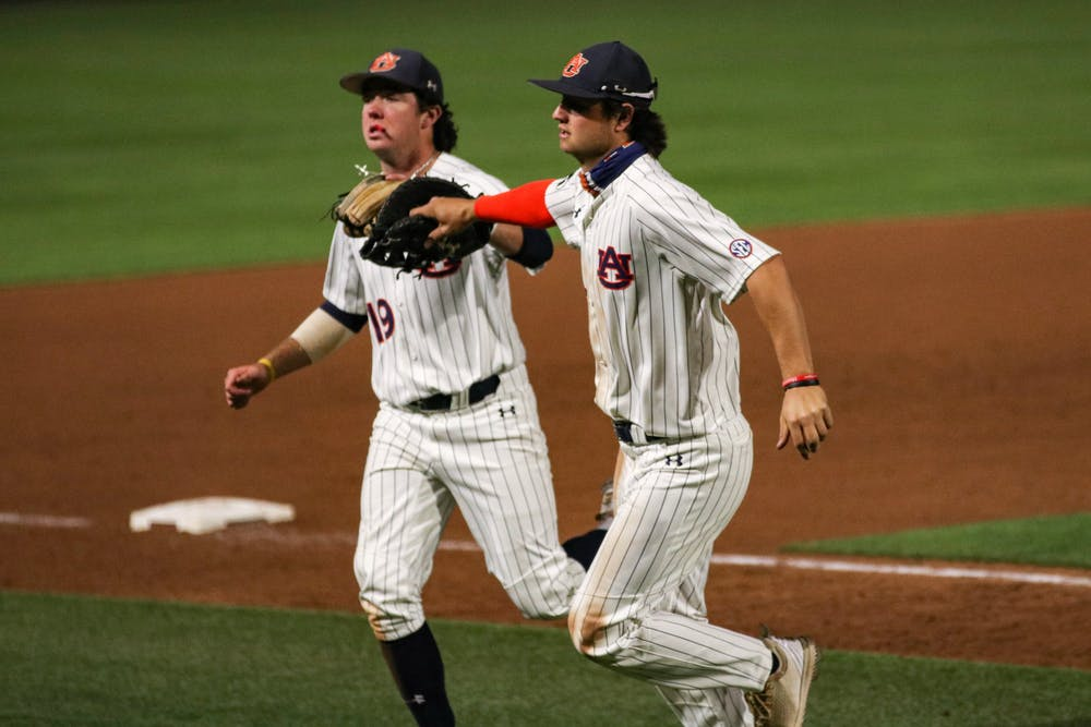 042121-auburn-img-8402-brody-moore-and-tyler-miller-react-after-a-play