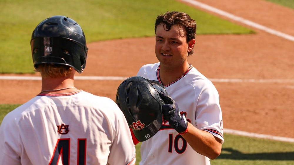 051521-auburn-img-6604-tyler-miller-reacts-with-steven-williams-after-a-home-run