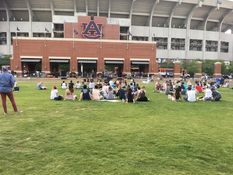 Students sit on the Green Space in protest of Richard Spencer.