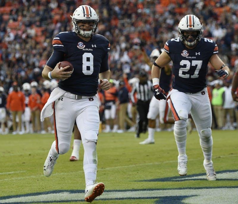 Auburn's Jarrett Stidham runs in for a touchdown in the first half.Liberty at Auburn on Saturday, Nov 17, 2018 in Auburn, Ala.Todd Van Emst/AU Athletics