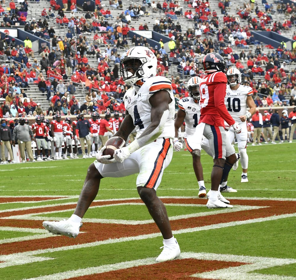 Oct 3, 2020; Oxford, MS, USA; Tank Bigsby (4) reacts after first quarter touchdown during the game between Auburn and Ole Miss at Vaught Hemingway Stadium. Mandatory Credit: Todd Van Emst/AU Athletics