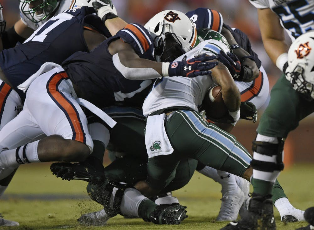 Big Kat Bryant and Marlon Davidson tackle QU Amare Jones. Auburn Football Tulane at Auburn on Saturday, Sept. 7, 2019 in Auburn, Ala.