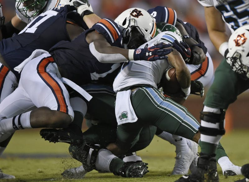 Big Kat Bryant and Marlon Davidson tackle QU Amare Jones. Auburn Football Tulane at Auburn on Saturday, Sept. 7, 2019 in Auburn, Ala.