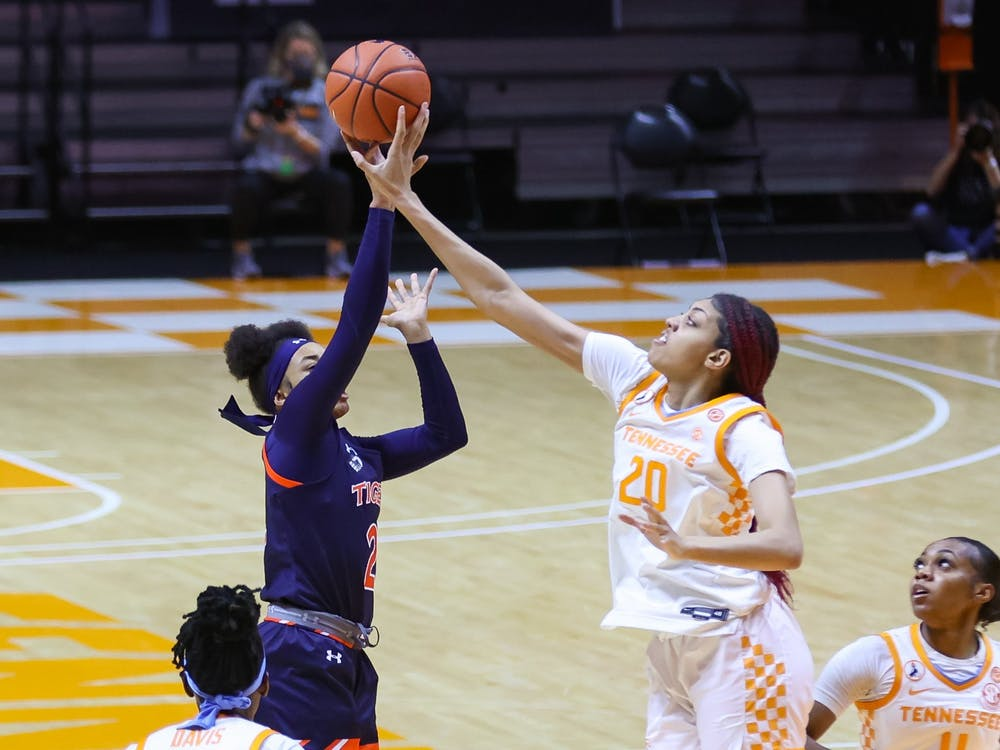 Feb 28, 2021; Knoxville, Tennessee, USA; Tennessee Lady Vols center Tamari Key (20) blocks a shot from Auburn Tigers forward Unique Thompson (20) during the first half at Thompson-Boling Arena. Mandatory Credit: Randy Sartin-USA TODAY Sports