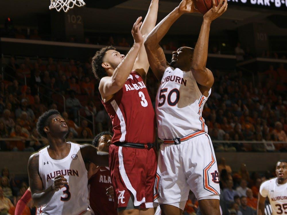 Auburn center Austin Wiley (50) shoots a basket in the first half.AU MBB v Alabama on Wednesday, Feb. 12, 2020 in Auburn, Ala. Todd Van Emst/AU Athletics