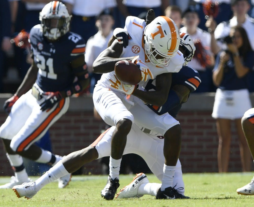 Auburn's Jamel Dean knocks the ball from Tennessee receiver Marquez Callaway in the first half.Tennessee at Auburn on Saturday, Oct. 13, 2018 in Auburn, Ala.Todd Van Emst/AU Athletics