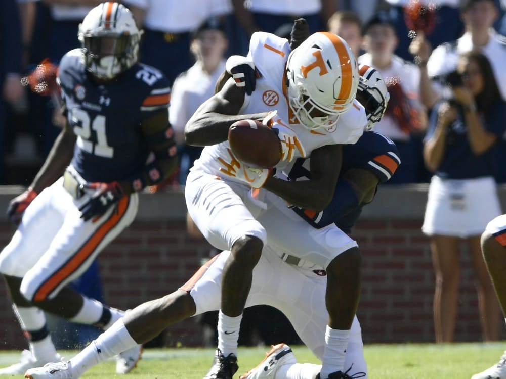 Auburn's Jamel Dean knocks the ball from Tennessee receiver Marquez Callaway in the first half.