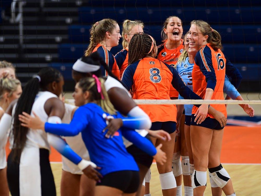 Oct 22, 2020; Auburn, AL, USA; Auburn Tigers volleyball team celebrates during the game between Auburn and Florida at Auburn Arena. Mandatory Credit: Shanna Lockwood/AU Athletics