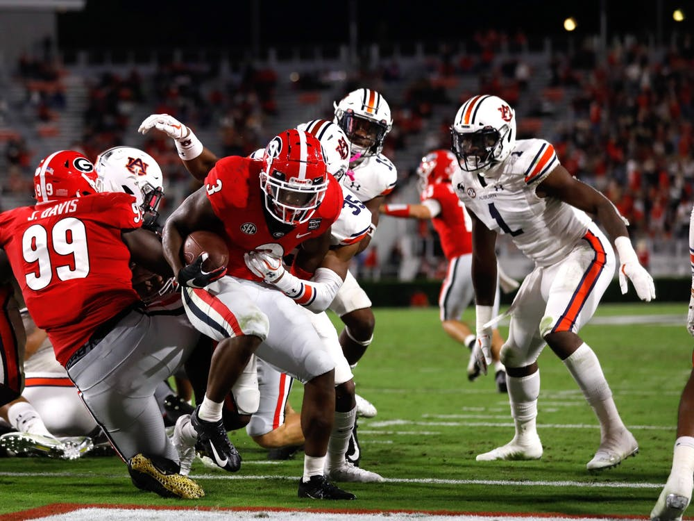 Georgia tailback Zamir White (3) scores during the Bulldogs' game against Auburn at Dooley Field at Sanford Stadium on Saturday, Oct. 3, 2020. (Photo by Andrew Davis Tucker)