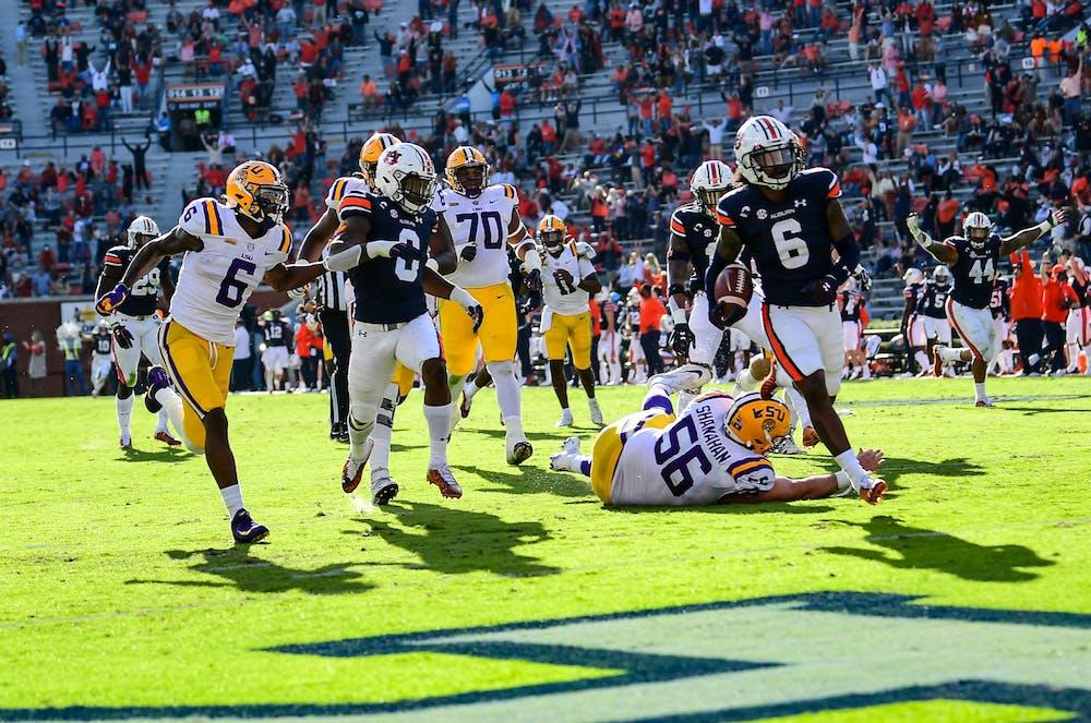 Oct 3, 2020; Auburn AL, USA; Christian Tutt (6) runs the ball for a touchdown during the game between Auburn and LSU at Jordan Hare Stadium. Mandatory Credit: Shanna Lockwood/AU Athletics