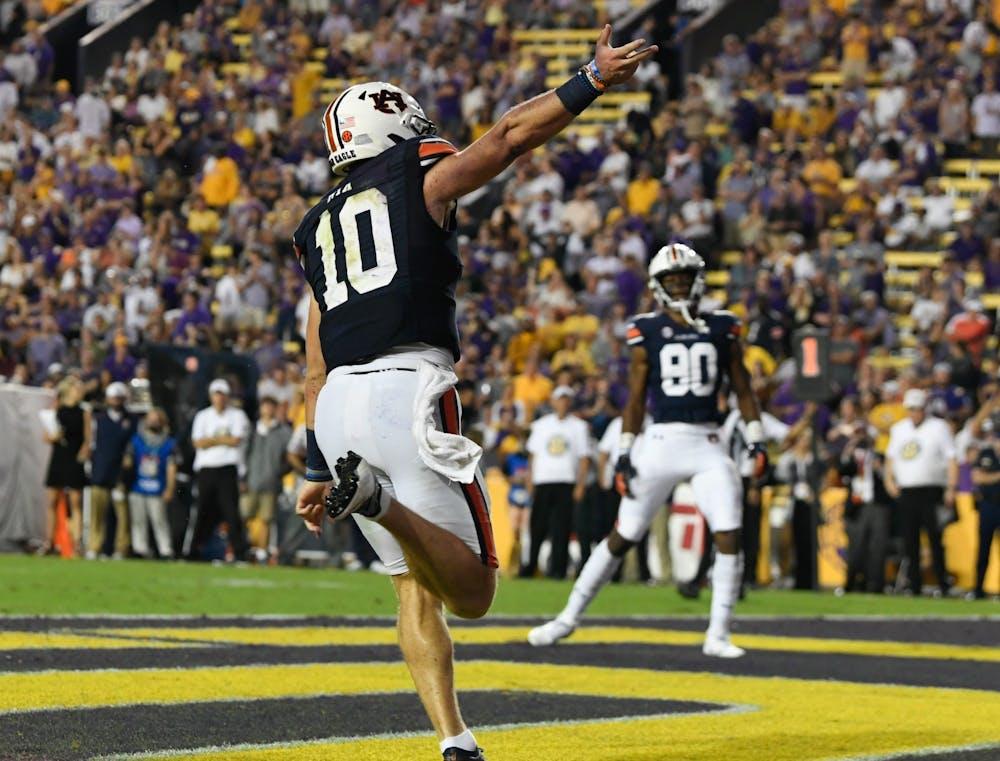 Oct 2, 2021; Baton Rouge, LA, USA; Bo Nix (10) touchdown between Auburn and Louisiana State University at Tiger Stadium. Mandatory Credit: Todd Van Emst/AU Athletics