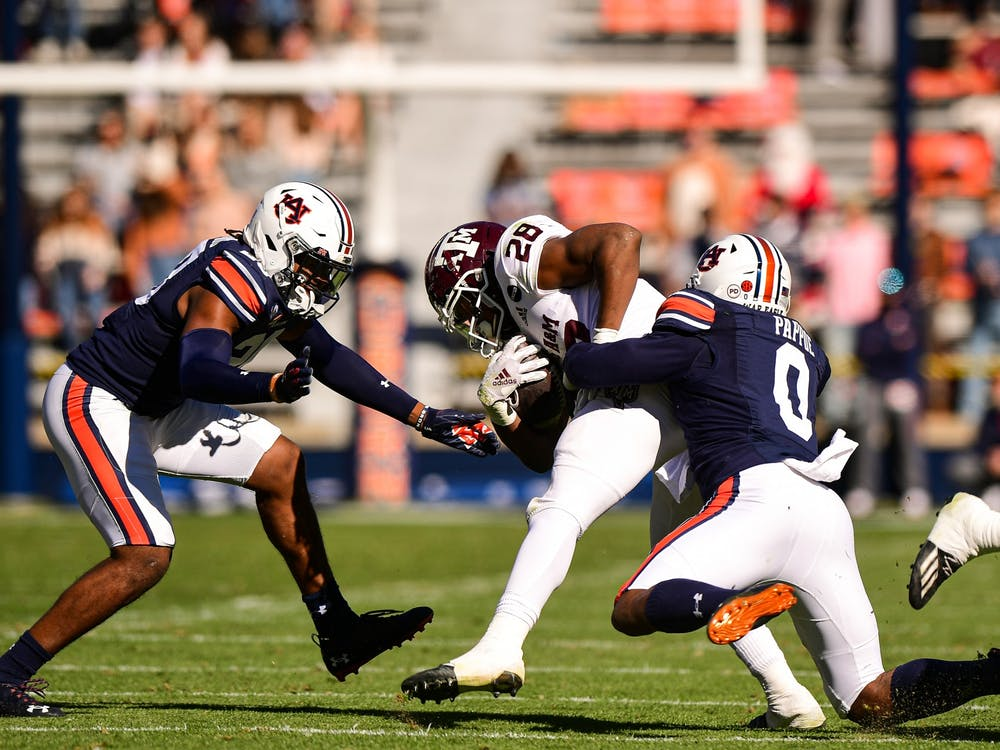 Dec 5, 2020; Auburn AL, USA; Auburn Tigers linebacker Owen Pappoe (0) gets a tackle during the game between Auburn and Texas A&M at Jordan Hare Stadium. Mandatory Credit: Shanna Lockwood/AU Athletics