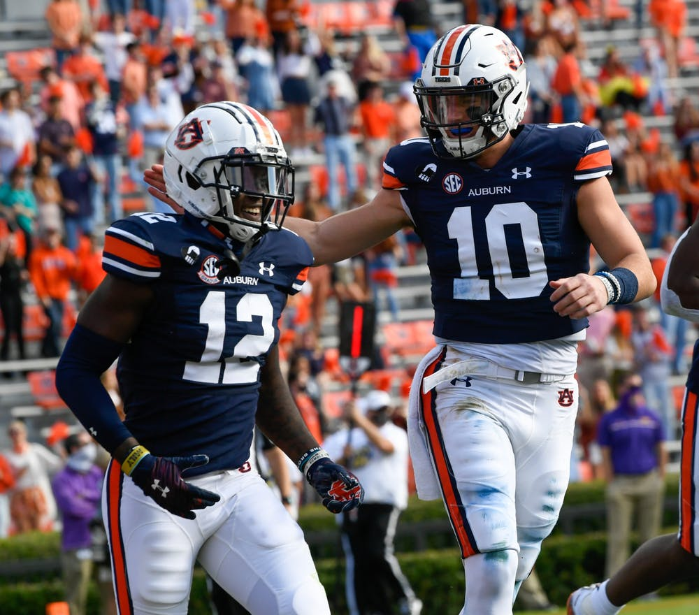 Oct 3, 2020; Auburn AL, USA; Bo Nix (10) celebrates with Eli Stove (12) after the touchdown during the game between Auburn and LSU at Jordan Hare Stadium. Mandatory Credit: Todd Van Emst/AU Athletics