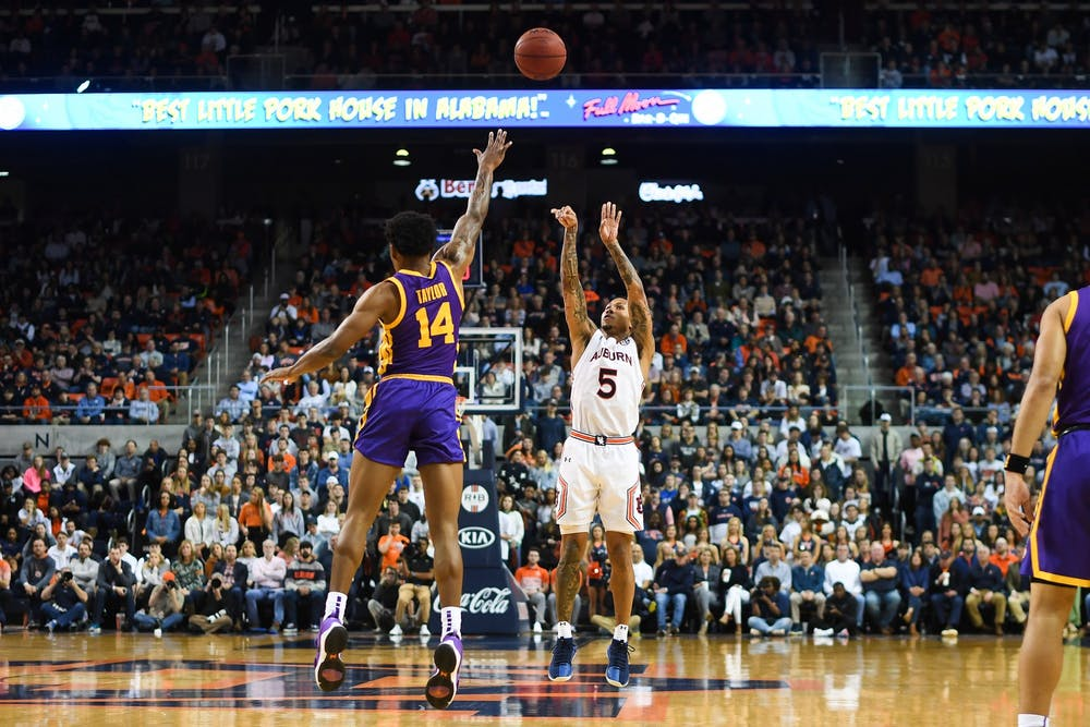 Feb 8, 2020; Auburn, AL, USA; Auburn Tigers guard J'Von McCormick (5) shoots during the game against LSU at Auburn Arena. Mandatory Credit: Shanna Lockwood/AU Athletics