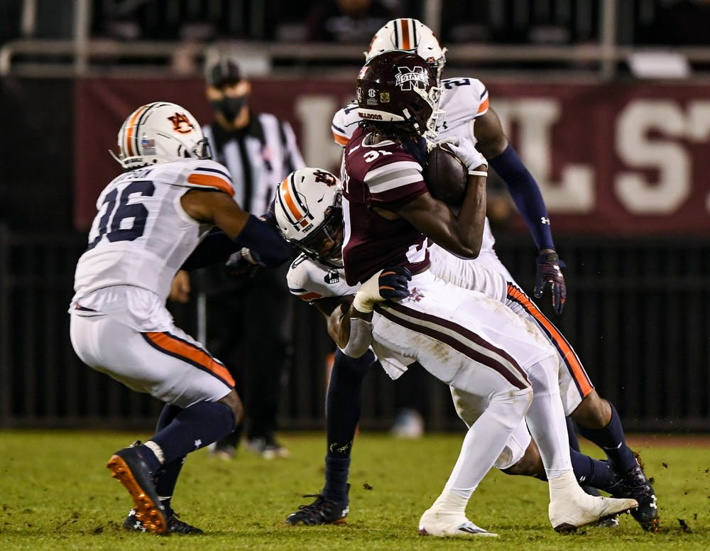 Oct 3, 2020; Starkville, Mississippi, USA; Owen Pappoe (0) gets a sack during the game between Auburn and Mississippi State at Davis Wade Stadium. Mandatory Credit: Todd Van Emst/AU Athletics