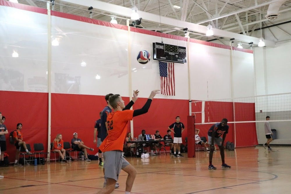 Libero, Michael Hickey, going up for a serve winning Auburn the point.