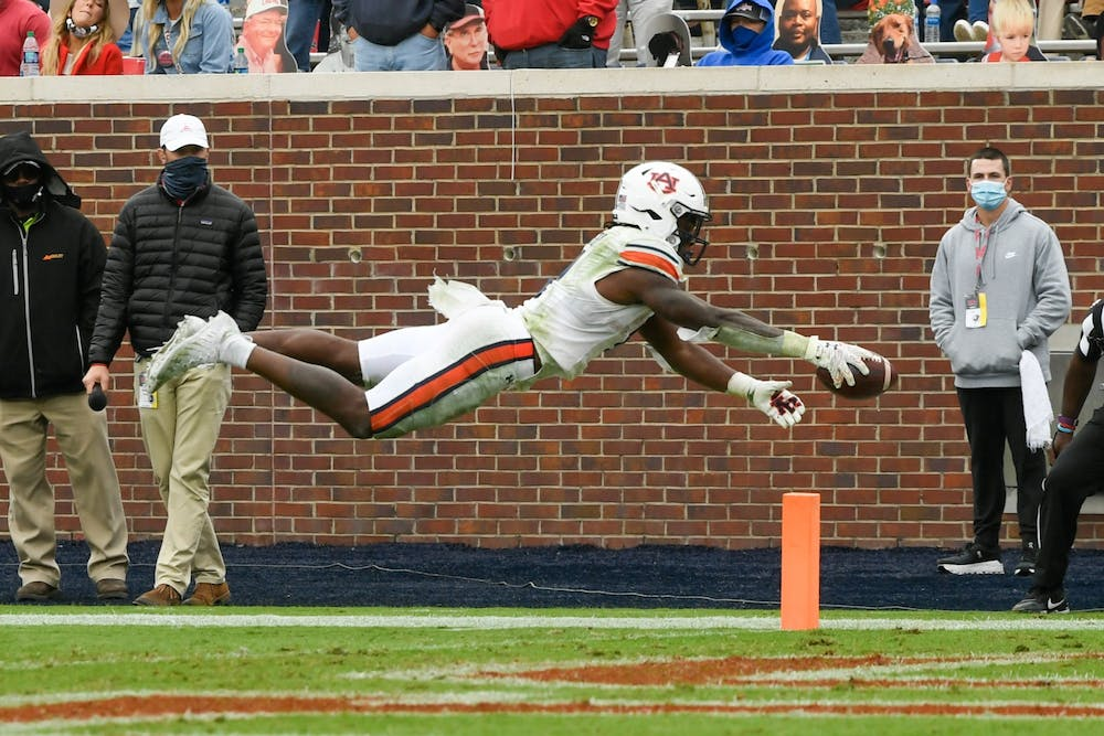 Oct 3, 2020; Oxford, MS, USA; Tank Bigsby (4) dives for the touchdown during the game between Auburn and Ole Miss at Vaught Hemingway Stadium. Mandatory Credit: Todd Van Emst/AU Athletics