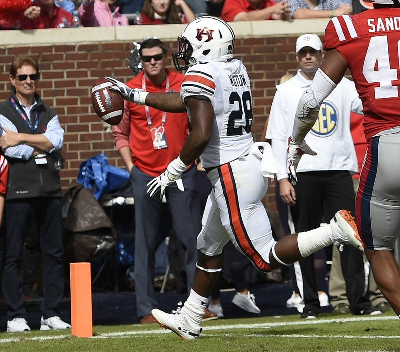 Auburn's JaTarvious Whitlow scores a touchdown in the first half.Auburn at Ole Miss on Saturday, Oct. 20, 2018 in Oxford, MS.Todd Van Emst/AU Athletics