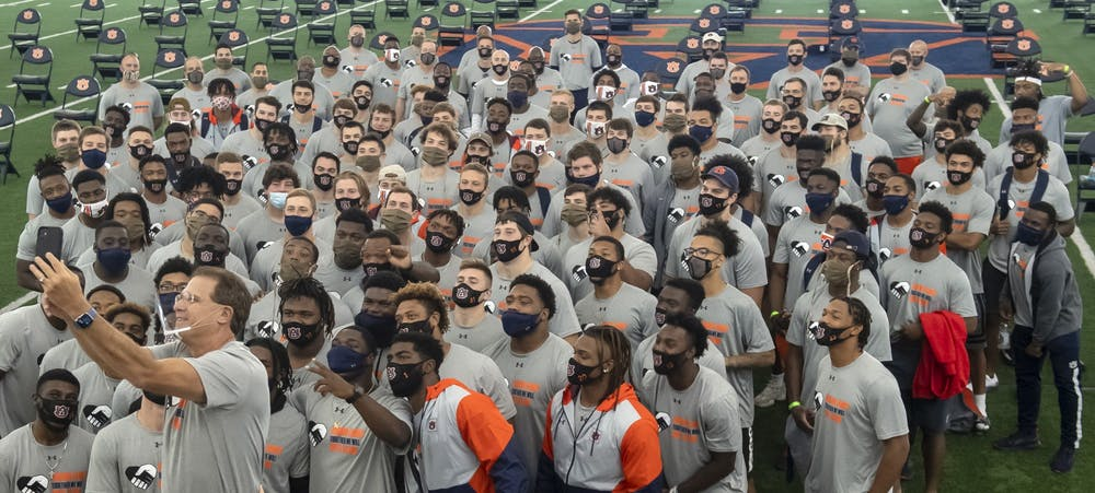 Auburn coach Gus Malzahn takes a selfie with his team to thank everyone for the money raised for minority scholarships so far. The team also had the opportunity to register to vote after this picture on Saturday, Sept. 19, 2020 in Auburn, Ala. Todd Van Emst/AU Athletics#TogetherWeWill