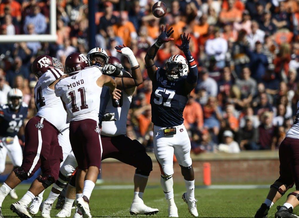 Auburn;s Deshaun Davis pressures A&M quarterback Mond Kellen into n incomplete pass in the first half.Texas A&M at Auburn football on Saturday, Nov 3, 2018 in Auburn, Ala.Todd Van Emst/AU Athletics