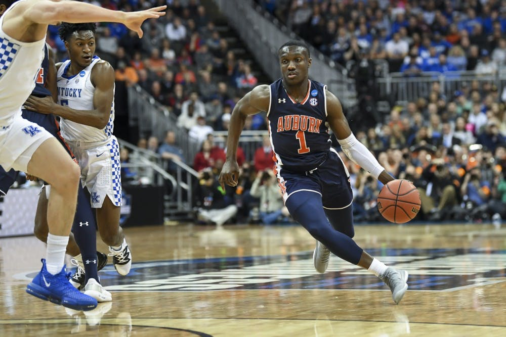 <p>Jared Harper (1) Auburn men's basketball vs Kentucky during the NCAA Midwest Regional final on Sunday, March 31, 2019, in Kansas City, Mo.&nbsp;&nbsp;</p>