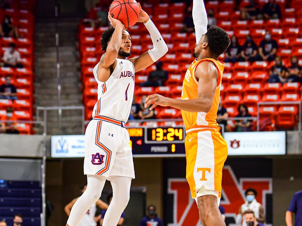 Feb 27, 2021; Auburn, AL, USA; Auburn Tigers guard Jamal Johnson (1) shoots a contested three during the game between Auburn and Tennessee at Auburn Arena. Mandatory Credit: Shanna Lockwood/AU Athletics