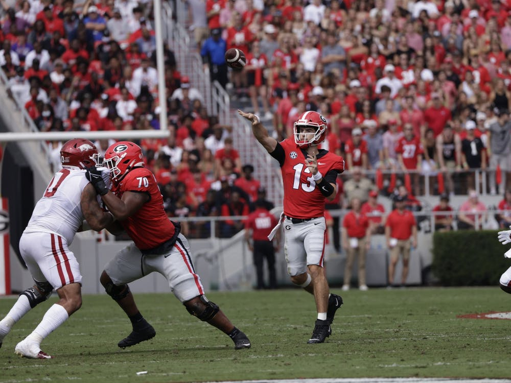 Georgia quarterback Stetson Bennett (13) during the Bulldogs' game with Arkansas in Dooley Field at Sanford Stadium in Athens, Ga., on Saturday, Oct. 2, 2021. (Photo by Andrew Davis Tucker)
