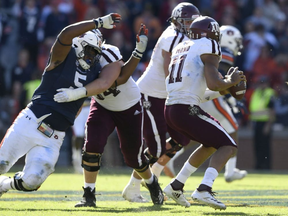Auburn's Derrick Brown pressures A&M quarterback Mond Kellen in the second half. Texas A&M was called for a hold on the play.