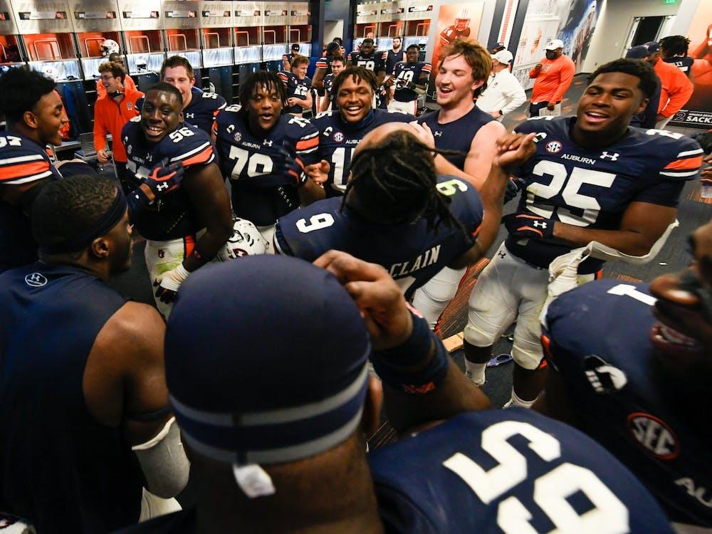 Oct 3, 2020; Auburn AL, USA; Group of players celebrating in the locker room after the game between Auburn and LSU at Jordan Hare Stadium. Mandatory Credit: Todd Van Emst/AU Athletics