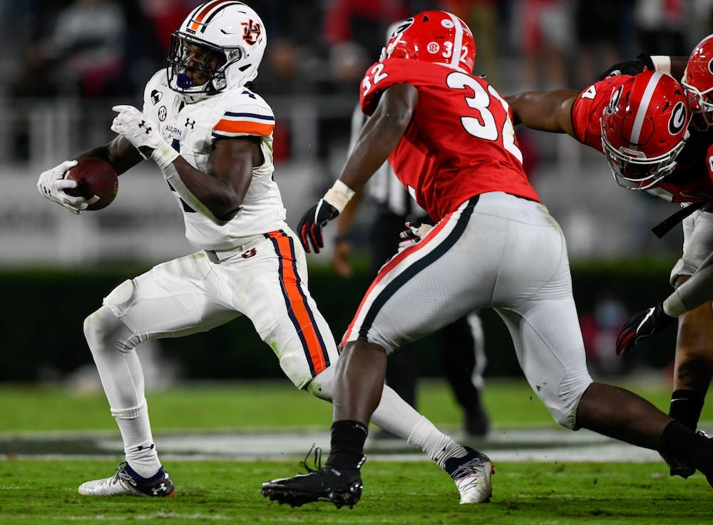 Oct 3, 2020; Athens, GA, USA; Tank Bigsby (4) rushes to the outside during the game between Auburn and Georgia at Samford Stadium. Mandatory Credit: Todd Van Emst/AU Athletics