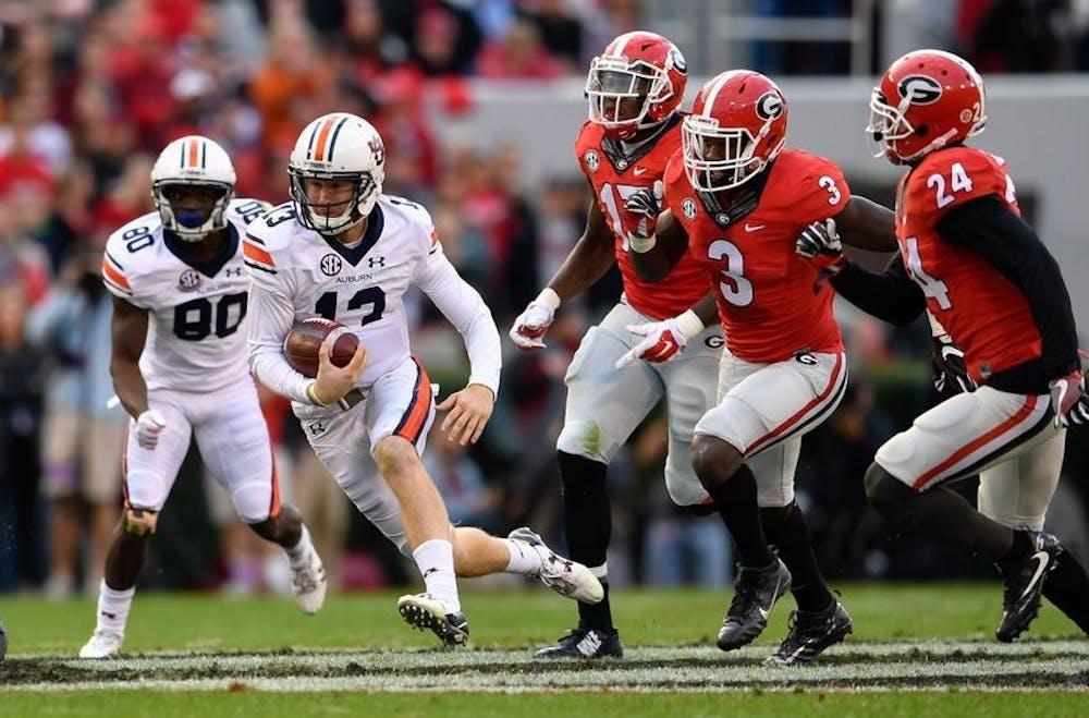 Nov 12, 2016; Athens, GA, USA; Auburn Tigers quarterback Sean White (13) runs against the Georgia Bulldogs defense during the second quarter at Sanford Stadium. Mandatory Credit: Dale Zanine-USA TODAY Sports