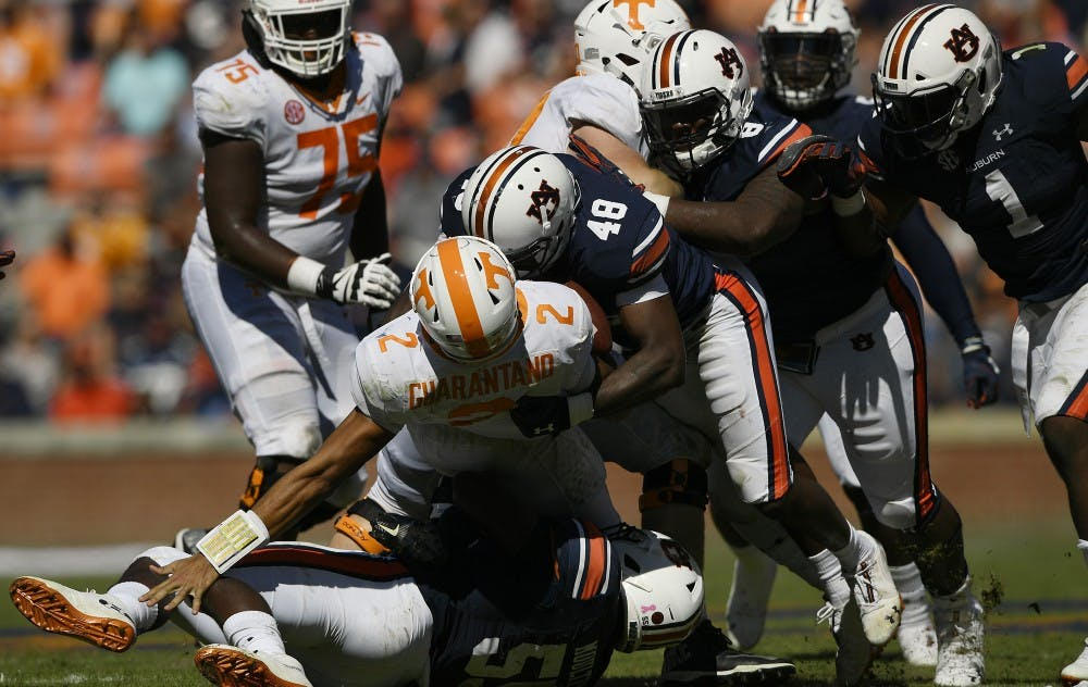 Derrick Brown and Montavious Atkinson sack Tennessee quarterback Jarrett Guarantano in the second half.