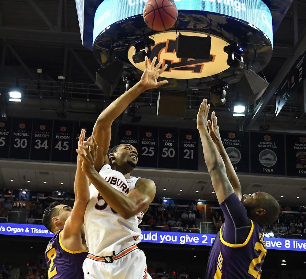 Austin Wiley (50) shoots in the first half.  Auburn Mens Basketball vs Lipscomb on Sunday, December 29, 2019 in Auburn, Ala.Anthony Hall/Auburn Athletics